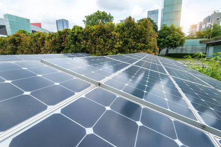 green energy resources: Solar Panels In The Park Of Modern City Stock Photo