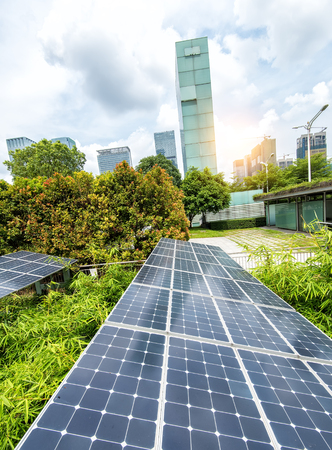 green technology: Solar Panels In The Park Of Modern City Stock Photo