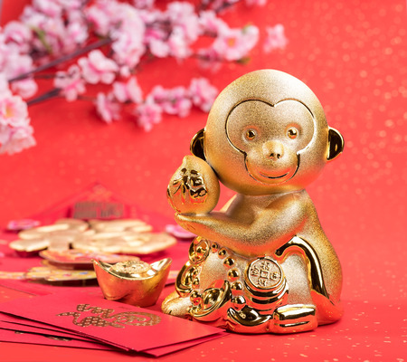 lunar new year: 2016 is year of the monkey,golden monkey with decoration,calligraphy fu mean good bless