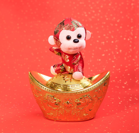 color of year: chinese monkey toy on red background