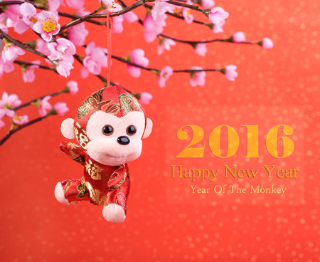 chinese new year element: Chinese lunar new year ornaments toy of monkey on festive background Stock Photo