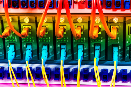 tcp: Fiber Optic cables connected to an optic ports and Network cables connected to the ports