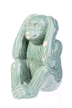 contorted: ceramic monkey isolated