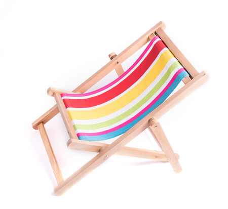 idling: wooden striped deck chair isolated on white background