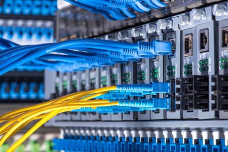 Fiber Optic cables connected to an optic ports and Network cables connected to the ports