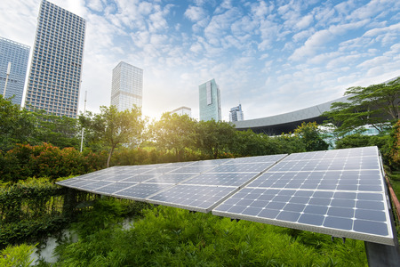 solar cell: Solar Panels In The Park Of Modern City Stock Photo