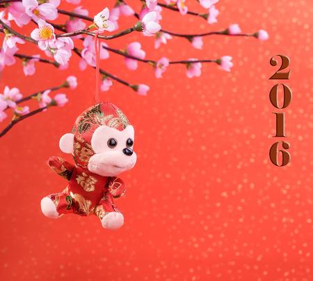 nudo: Nuevo juguete adornos de a�o lunar chino del mono en el fondo de fiesta