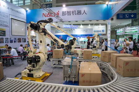 influential: SHENZHEN - MARCH 30: International Machinery Manufacturing Industry Exhibition is one of the mainland's largest and most influential machinery show. on march 30, 2015 in Shenzhen, China.