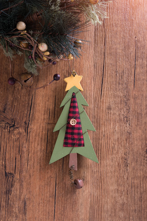 tree decorations: christmas wooden decorations christmas tree hanging on wooden background