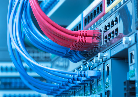 isp: network cables and hub closeup with fiber optical background