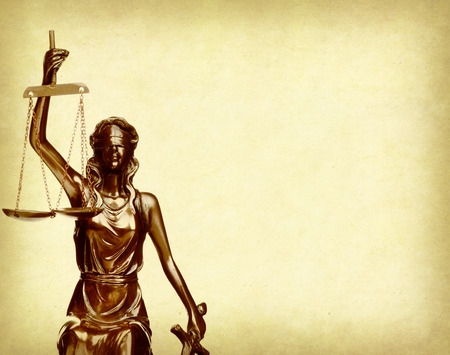 justness: Statue of justice on old paper background, law concept