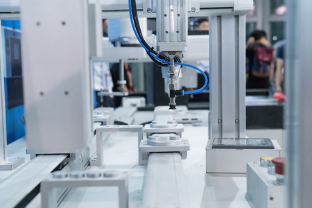 robot arm: Robot arm in a factory working Stock Photo
