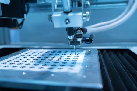 工場作業でロボット アーム 写真素材