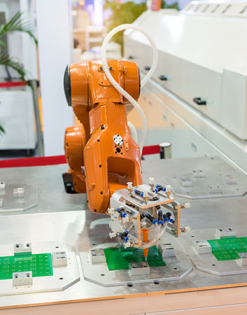 production line factory: Robotic arm at production line in factory Stock Photo