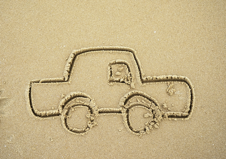 estival: car drawing in the sand