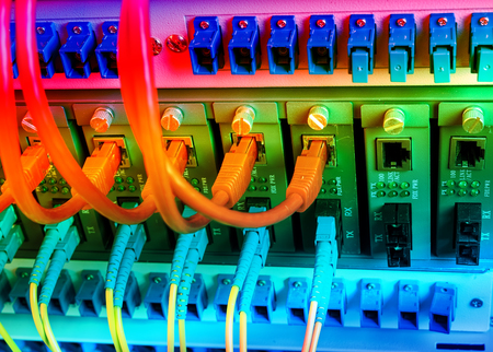 tcp ip: Fiber Optic cables connected to an optic ports and Network cables connected to ethernet ports