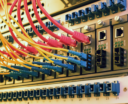 tcp: Fiber Optic cables connected to an optic ports and Network cables connected to ethernet ports