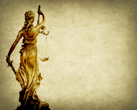 judicature: Statue of justice on old paper background with gavel, law concept Stock Photo