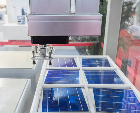 production of solar panels, Industrial robot working in factory,Conveyor Tracking Controler of robotic hand.