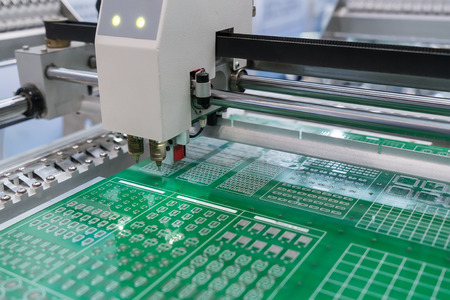 PCB Processing on CNC machine working in factory Foto de archivo