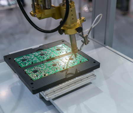 pcb: PCB Processing on CNC machine working in factory Stock Photo
