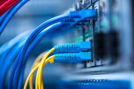 ethernet: Fiber Optic cables connected to an optic ports and Network cables connected to ethernet ports