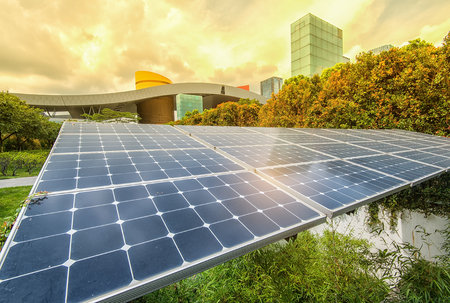 Solar Panels In The Park Of Modern City Stock Photo