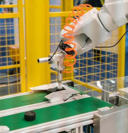 automated tooling: Industrial robot working in factory,Controler of robotic hand.