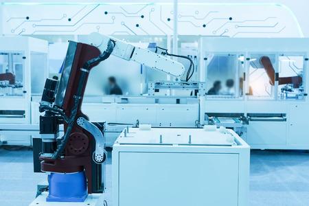 Industrial robot working in factory,Controler of robotic hand.