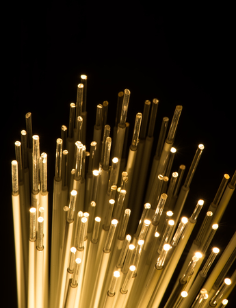 photon: optical fibres dinamic flying from deep on technology background