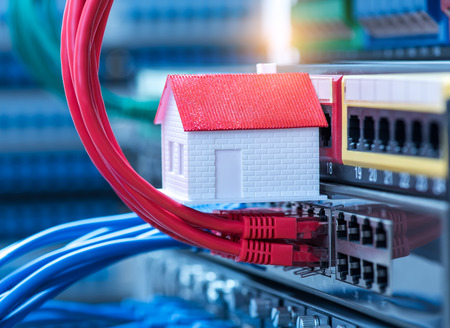 ethernet: small house on Network switch and ethernet cables