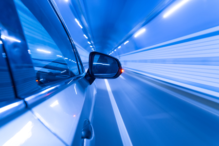 Speeding car  in tunnel. Stock Photo