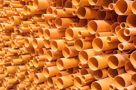ditch: PVC pipes stacked in construction site