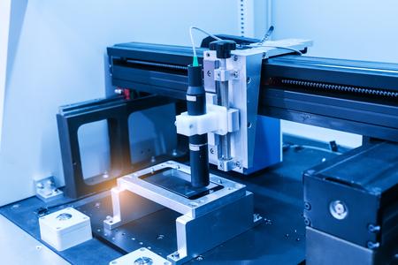 Industrial robot working in phone factory Standard-Bild