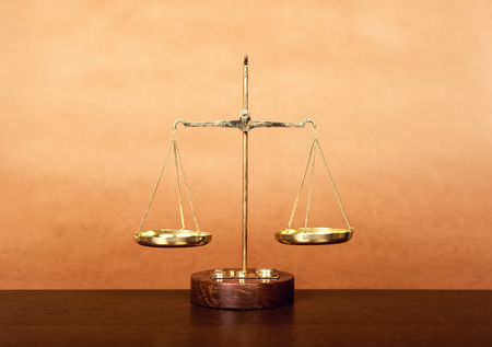 judicial proceeding: scales on wooden table, law concept