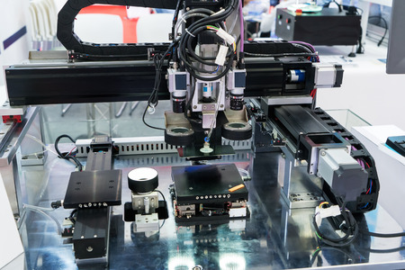Robotic machine vision system in phone factory Stok Fotoğraf