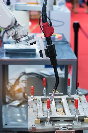 automate: robotic arm for welding in factory