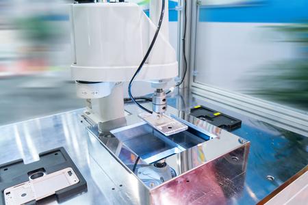 Industrial robot working in phone factory Reklamní fotografie