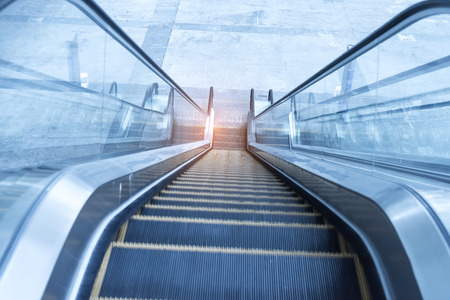 rapid steel: ascending escalator in a public transport area