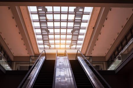 escalate: ascending escalator in a public transport area
