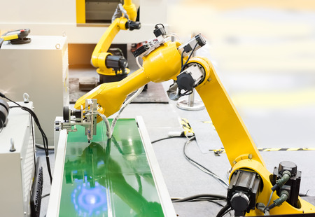 machine: Robotic machine vision system in phone factory Stock Photo