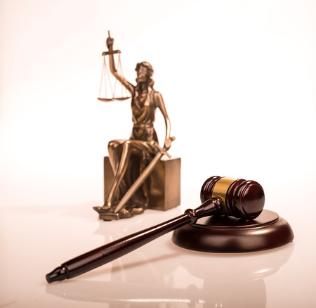 libra: Wooden gavel on wooden table, law concept