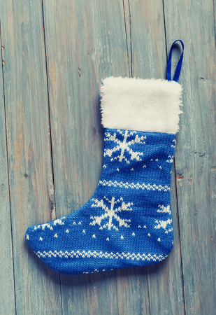 christmas sock: Christmas sock with on wooden background