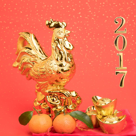 2017 is year of the Rooster,Gold Rooster,Chinese calligraphy translation: Rooster.Red stamps which Translation: good bless for new year Stock Photo
