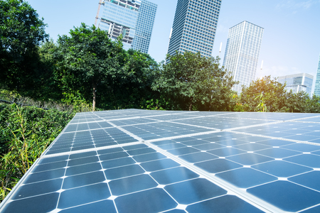 clean commercial: Solar Panels In The Park Of Modern City Stock Photo