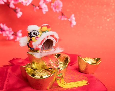 exotic flowers: chinese traditional dancing lion with Gold ingot,Chinese calligraphy Translation:good bless for money
