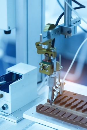 automate: Automatic robot in assembly line working in factory.