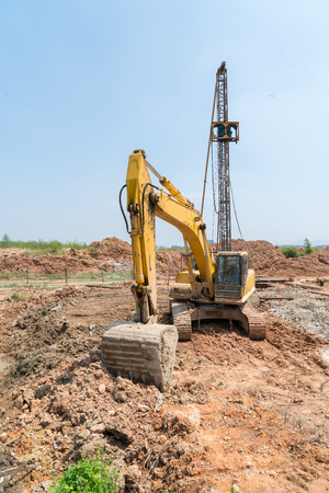 Heavy earth mover with blue sky in the background Stock Photo
