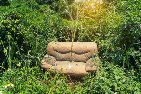 disposed: sofa abandoned in the grass Stock Photo