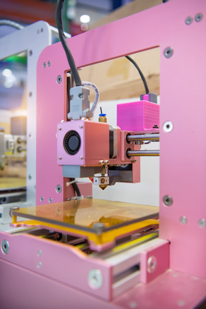 fused: 3D printer on a pink background Stock Photo